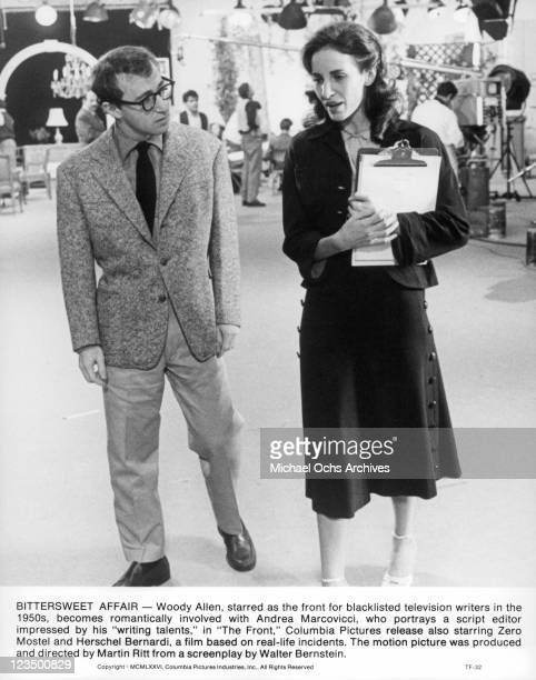 Woody Allen walking with Andrea Marcovicci in a scene from the film 'The Front' 1976