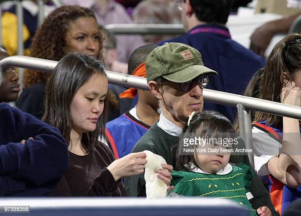 Woody Allen wife SoonYi and daughter Bechet Dumaine Allen are in attendance as the Knicks are defeated by the Philadelphia 76ers 9392 at Madison...