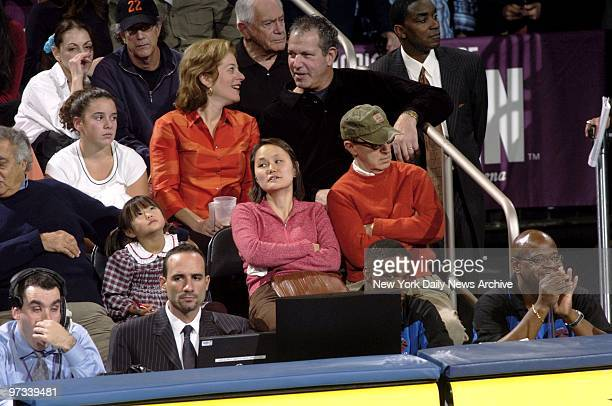 Woody Allen wife SoonYi and daughter Bechet Dumaine appear to be less than riveted during the second half of the New York Knicks' home opener against...