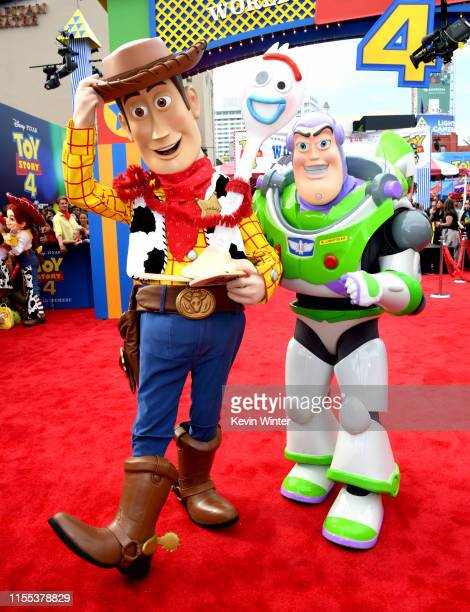 "Woody and Buzz Lightyear pose at the premiere of Disney and Pixar's ""Toy Story 4"" at the El Capitan on June 11, 2019 in Los Angeles, California."