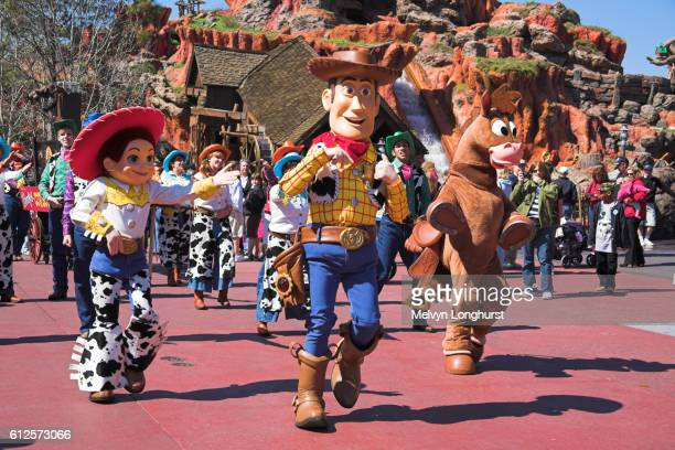woody and jessie in parade near splash mountain, frontierland, magic kingdom, disney world, orlando, florida, usa - disney world stock pictures, royalty-free photos & images
