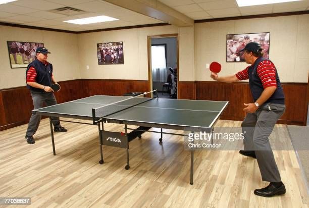 Woody Austin and Phil Mickelson plays a game of table tennis in the team cabin before practice for The Presidents Cup on September 26 at The Royal...