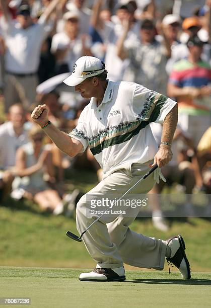 Woody Austin celebrates his birdie putt on the 12th green during the final round of the 89th PGA Championship at the Southern Hills Country Club on...