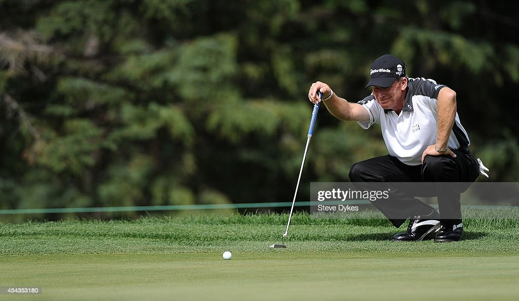 Woody Austin lines up his birdie putt attemp on the fifth hole during the first round of the Shaw Charity Classic on August 29, 2014 in Calgary, Canada.