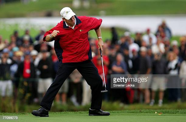 Woody Austin of the U.S. Team celebrates after making a putt on the 17th hole during the second round of fourball matches at The Presidents Cup at...