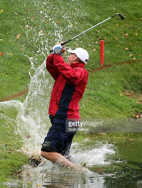Woody Austin of the US Team hits a shot from the water on the 14th hole during the round two fourball matches at the Presidents Cup at The Royal...