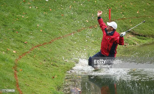 Woody Austin of the U.S. Team plays his second shot from the water at the par 4, 14th hole during the round two fourball matches at the Presidents...