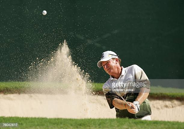Woody Austin plays a bunker shot on the fourth hole during the first round of the 89th PGA Championship at the Southern Hills Country Club on August...