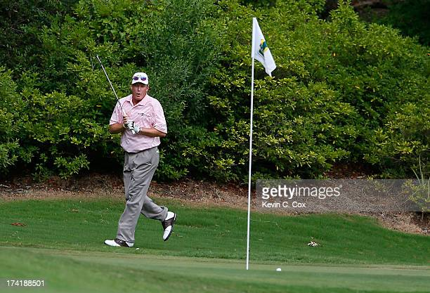 Woody Austin reacts after nearly chipping in for birdie on the 17th hole during the final round of the Sanderson Farms Championship at Annandale Golf...