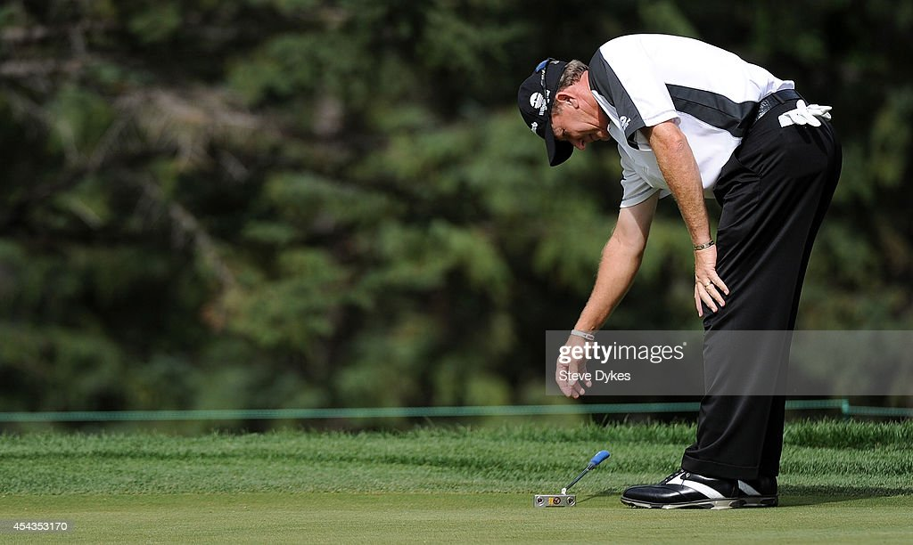 Woody Austin reacts as he misses his birdie putt attempt on the fifth hole during the first round of the Shaw Charity Classic on August 29, 2014 in Calgary, Canada.