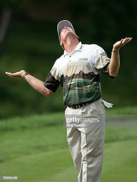 Woody Austin reacts as if looking for help from above during the final round of The Barclays held at Westchester Country Club August 26 2007 in...