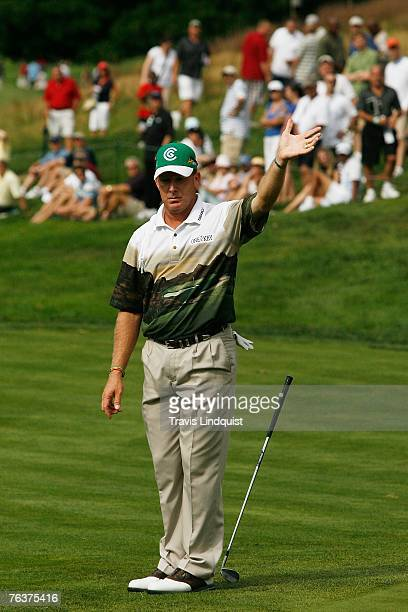 Woody Austin reacts to missing a short chip for birdie on the 12th hole during the final round of The Barclays the inaugural event of the new PGA...