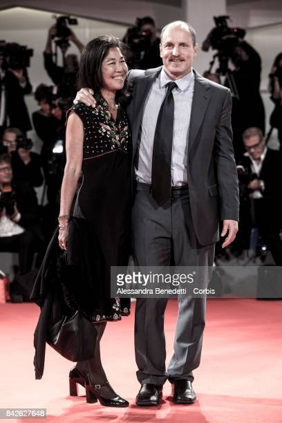 Woody Harrelson and Laura Louie walk the red carpet ahead of the 'Three Billboards Outside Ebbing Missouri' screening during the 74th Venice Film...