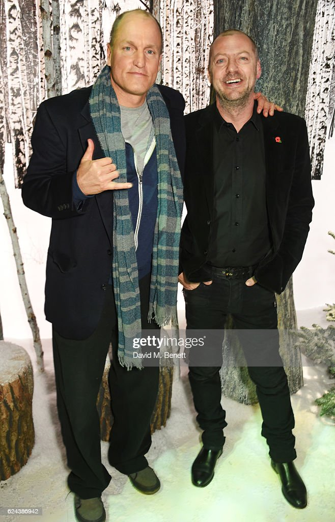 Woody Harrelson (L) and Matthew Freud attend Claridge's Christmas Tree 2016 Party, with tree designed by Sir Jony Ive and Marc Newson, at Claridge's Hotel on November 19, 2016 in London, England.