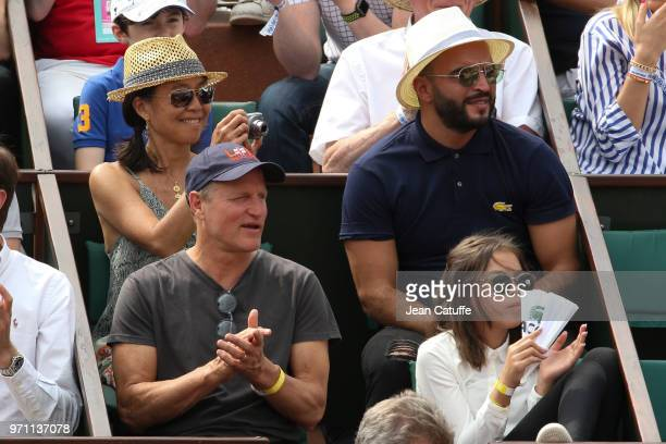 Woody Harrelson his wife Laura Louie and their daughter Makani Harrelson during the men's final on Day 15 of the 2018 French Open at Roland Garros...