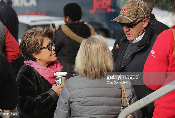 Woody Johnson billionaire owner of the New York Jets talks with Columba Bush wife of Republican presidential candidate Jeb Bush outside the polling...