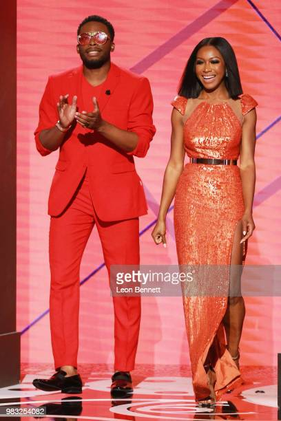 Woody McClain and Gabrielle Dennis speak onstage at the 2018 BET Awards at Microsoft Theater on June 24 2018 in Los Angeles California
