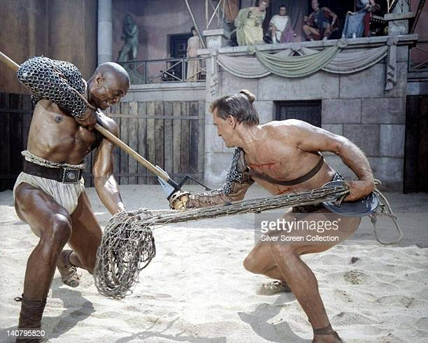 Woody Strode , US actor, and Kirk Douglas, US actor, in gladiatorial battle in a publicity still issued for the film, 'Spartacus', 1960. The...