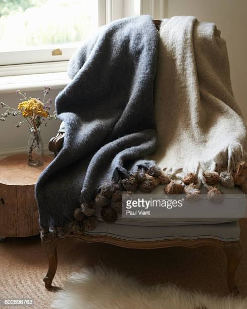 wool blankets on an armchair - bearskin rug imagens e fotografias de stock