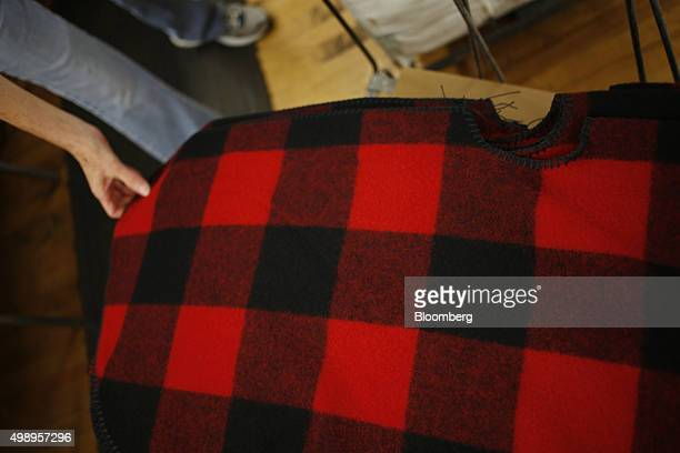 A wool Christmas tree skirt is seen at the Woolrich Inc woolen mill in Woolrich Pennsylvania US on Wednesday Nov 4 2015 Woolrich the legendary...