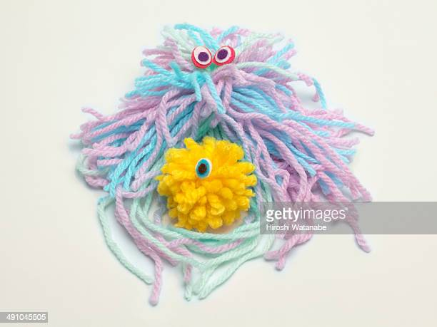 wool dolls of neutrophil attacking a germ - neutrophil stock photos and pictures