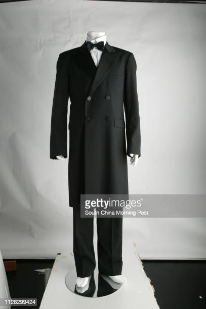 Wool frock coat with satin lapels and matching trousers with satin band from Agnes b.. 24 OCTOBER 2003