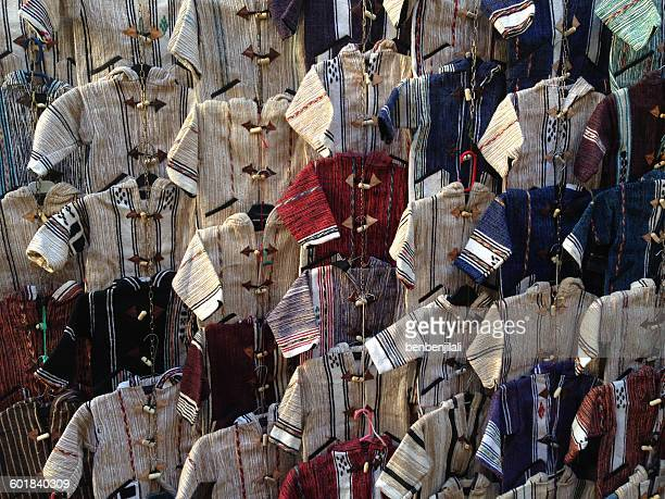 Wool jackets hanging in market, Fez, Morocco