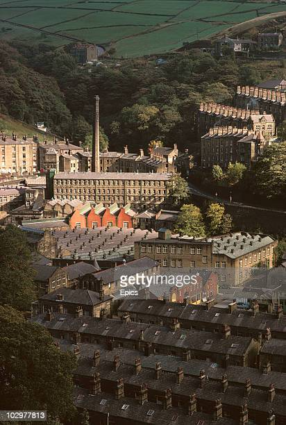 Wool mill is surrounded by terraced housing built for workers in a Pennine valley at Hebden Bridge.