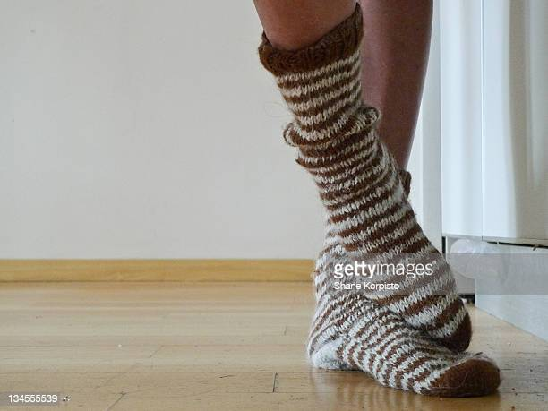 Wool socks on crossed feet