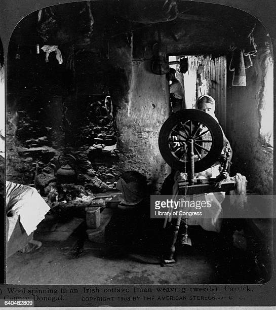 Wool spinning in an Irish cottage Carrick County Donegal Stereo c1903 by The