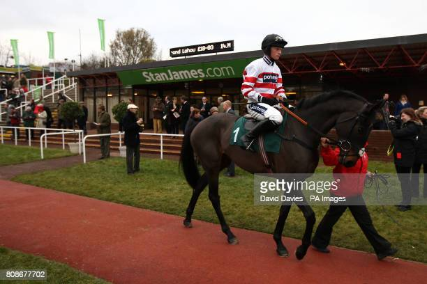 Woolcombe Folly with jockey Ryan Mahon is lead around the parade ring before the Jenny Mould Memorial Handicap Chase