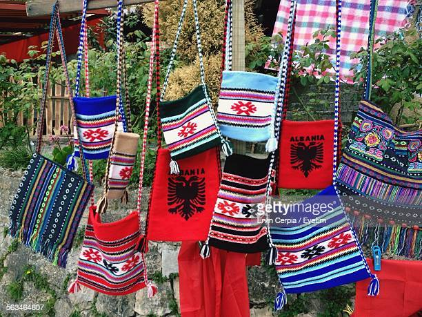 woolen purses hanging from market stall - bandiera albanese foto e immagini stock