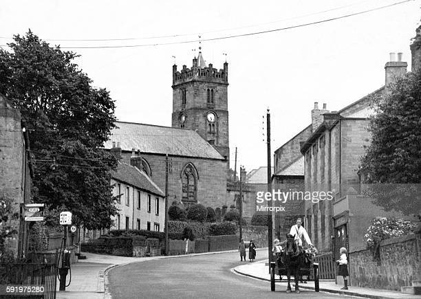 Wooler's parish church, in 1939, stands on Castle Hill, on the site of the thatched one burned down in 1721