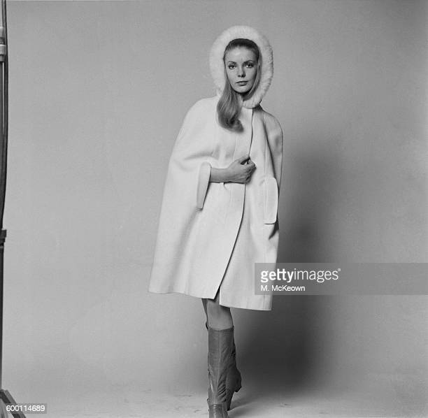 A woollen cape coat by Harbro worn by model Valerie UK 1st December 1967