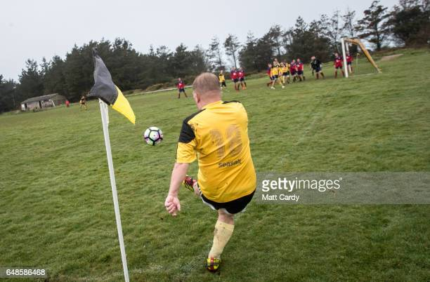 Woolpack Wanderers Matt Simons kicks the ball during the match between the Garrison Gunners and Woolpack Wanderers at the Garrison soccer field on St...