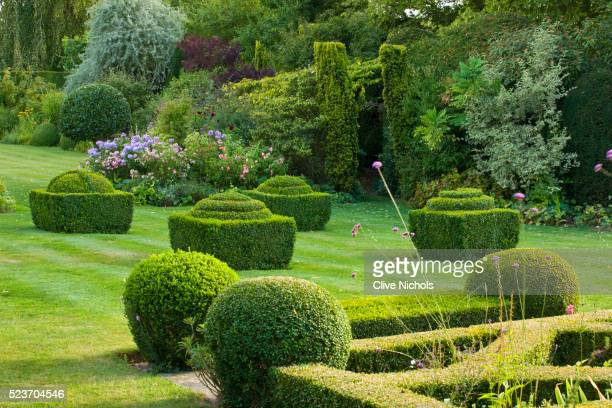 Woolstone Mill House, Oxfordshire: View from Formal Parterre with Box Fondants and Box Balls. Green,
