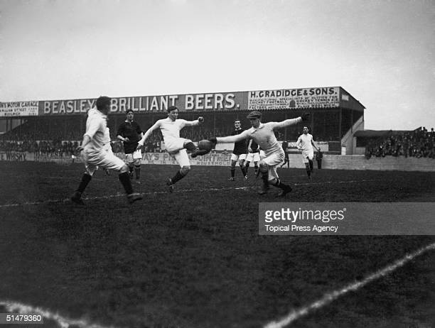 Woolwich Arsenal goalkeeper Harold Crawford reaches for a shot from a Manchester City striker during a game at Arsenal's Plumstead ground in South...