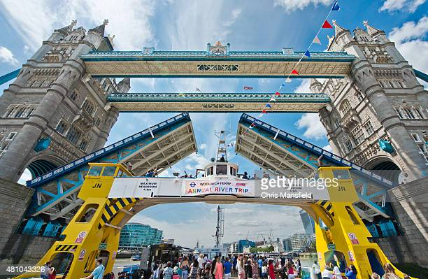 woolwich ferry at tower bridge - woolwich stock photos and pictures
