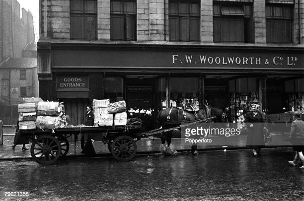 1951 Woolworth's department store pictured in Sauchiehall Street Glasgow Scotland as a horse drawn cart containing supplies pulls up outside
