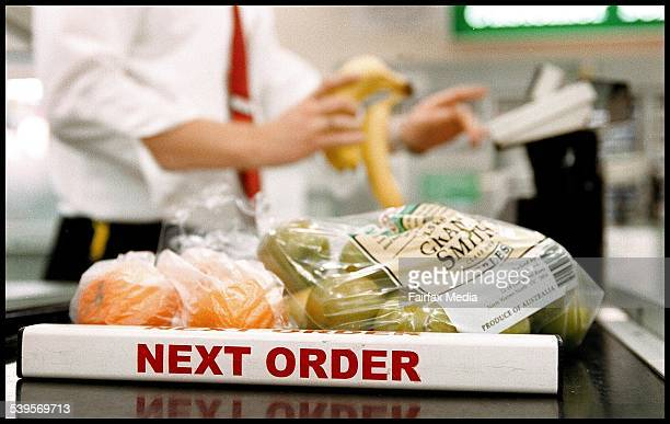 A Woolworths supermarket checkout with 'next order' sign 24 August 2004 AFR Picture by JIM RICE