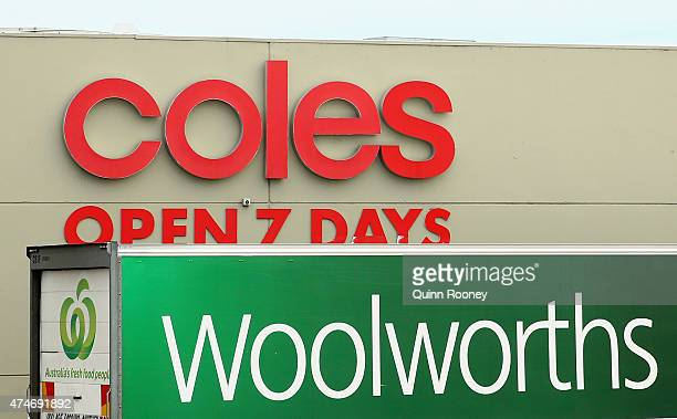 Woolworths truck is parked outside a Coles Supermarket on May 25 2015 in Melbourne Australia In a bid to regain its title as Australia's...