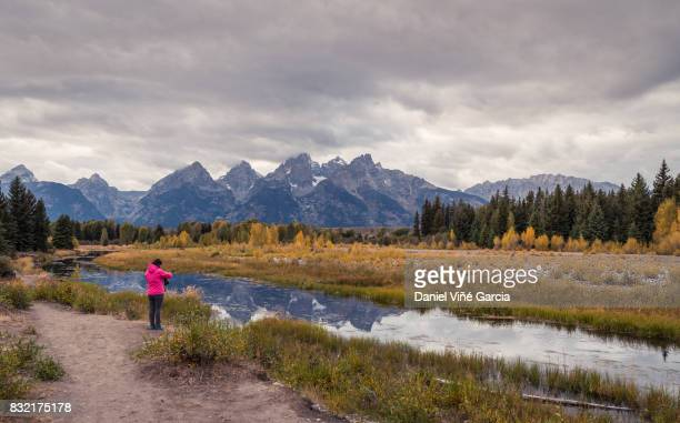 wooman looking in the snake river valley grand teton national park - jackson hole stock pictures, royalty-free photos & images