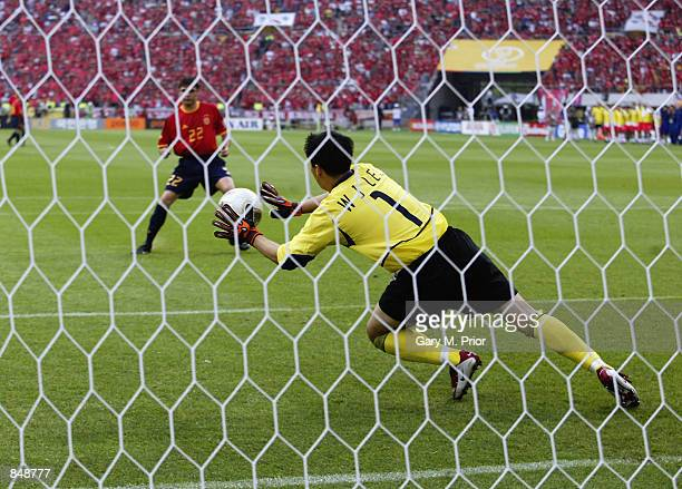 Woon Jae Lee of South Korea saves a penalty from Joaquin of Spain during the FIFA World Cup Finals 2002 Quarter Finals match played at the Gwangju...