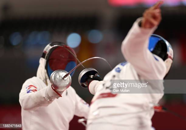Woongtae Jun of Team South Korea and Sergio Villamayor of Team Argentina compete during the Fencing Ranked Round of the Men's Modern Pentathlon on...