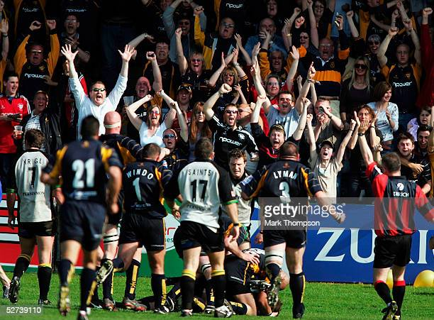 Worcester fans go wild as Drew Hickey scores the try that keeps his team in the Premiership during the Zurich Premiership match between Worcester...