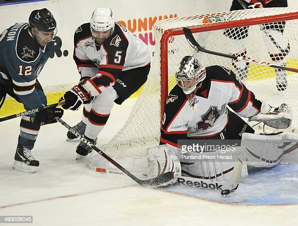 Worcester's Freddy Hamilton and Pirates Chris Summers watch the puck fly past goalie Mark Visentin as the Portland Pirates host the Worcester Sharks...