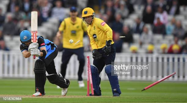 Worcestershire batsman Callum Ferguson is bowled by Josh Poysden as Bears wicketkeeper Tim Ambrose reacts during the Vitality Blast match between...
