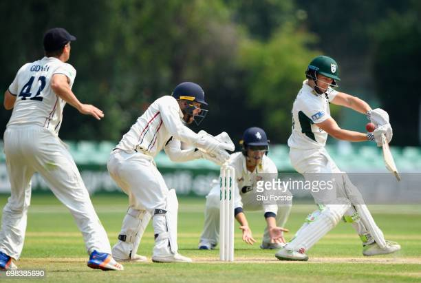 Worcestershire batsman Joe Clarke hits out during the Specsavers County Championship Division Two between Worcestershire and Kent at New Road on June...