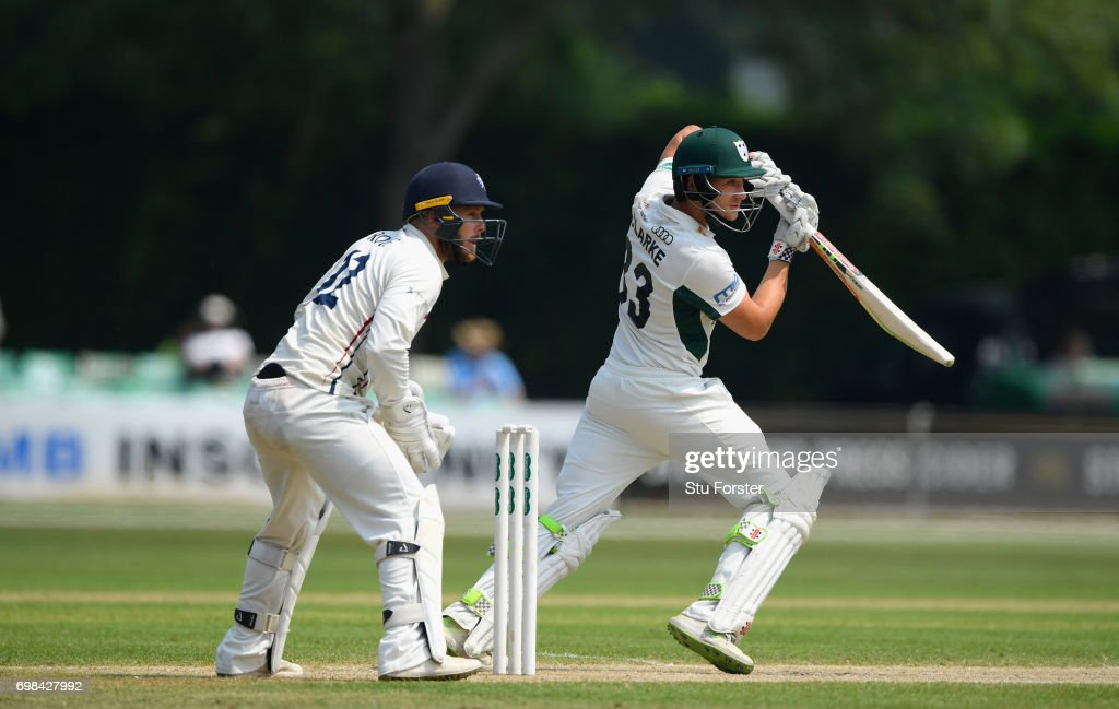 Worcestershire batsman Joe Clarke hits out watched by Adam Rouse during day two of the Specsavers County Championship Division Two between Worcestershire and Kent at New Road on June 20, 2017 in Worcester, England.