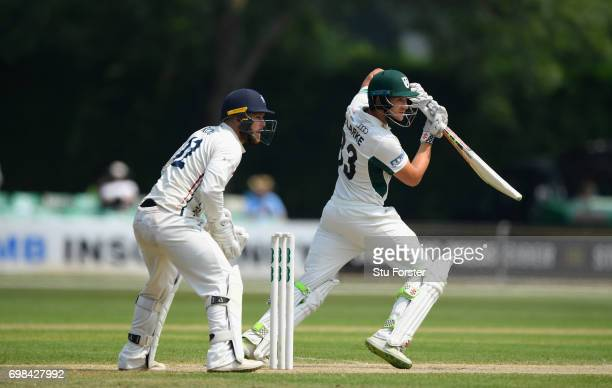Worcestershire batsman Joe Clarke hits out watched by Adam Rouse during day two of the Specsavers County Championship Division Two between...